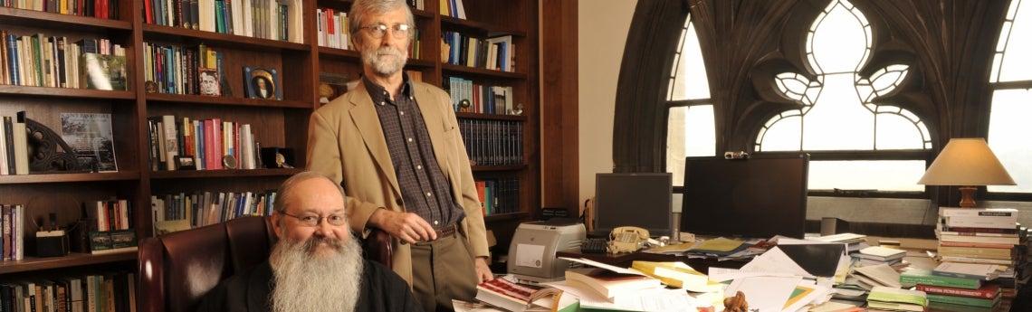 Philosophy faculty members Robert Brandom (seated) and John McDowell