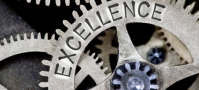 """a working gear labeled """"excellence"""""""