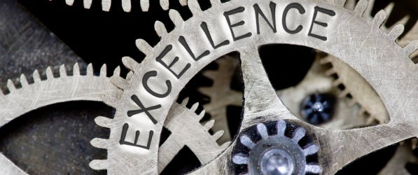 "a working gear labeled ""excellence"""